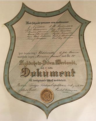 Bild på ett charter ser ut som ett diplom.